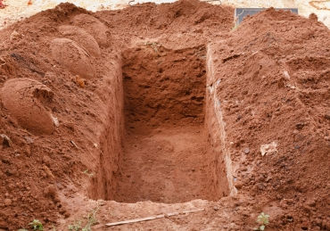 Preparing own grave whilst alive