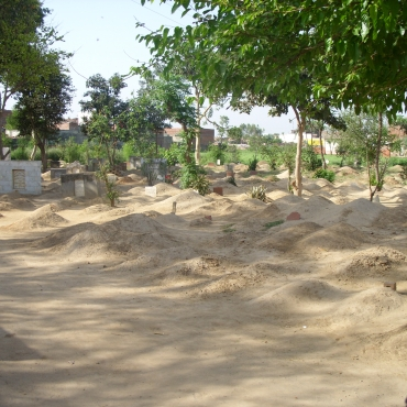 Women visiting graveyards